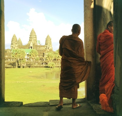 Monks look out at Angkor Wat