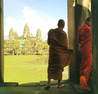 Monks look out at Angkor Wat
